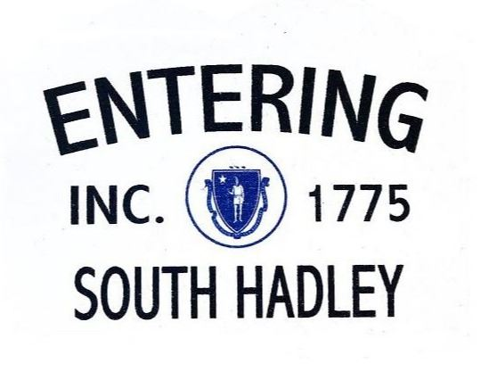 A white sign with text that says Entering South Hadley